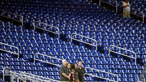 <p>               FILE - In this Monday, Sept. 9, 2019 file photo,Baseball fans stand among empty seats during the singing of the national anthem before a baseball game between the Miami Marlins and the Milwaukee Brewers in Miami.  Major League Baseball's average attendance dropped 1.7% this year for its fourth straight decline, and five of the six biggest drops were by teams with losing records. The 30 teams averaged 28,339, according to the commissioner's office, down from 28,830 last year _ the first time the average was below 30,000 since 2003. (AP Photo/Wilfredo Lee, File)             </p>