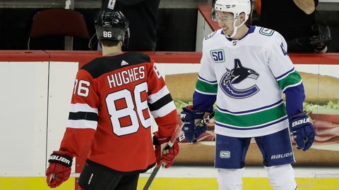 <p>               Vancouver Canucks' Quinn Hughes, right, talks to his brother New Jersey Devils' Jack Hughes, left, before of an NHL hockey game Saturday, Oct. 19, 2019, in Newark, N.J. The Devils won 1-0. (AP Photo/Frank Franklin II)             </p>