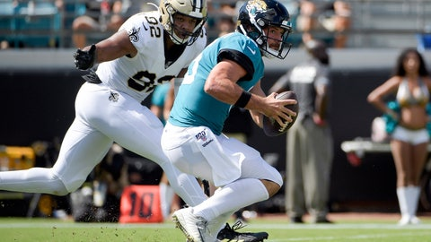 <p>               Jacksonville Jaguars quarterback Gardner Minshew, right, tries to scramble past New Orleans Saints defensive end Marcus Davenport (92) during the first half of an NFL football game, Sunday, Oct. 13, 2019, in Jacksonville, Fla. (AP Photo/Phelan M. Ebenhack)             </p>
