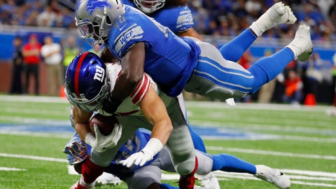<p>               New York Giants tight end Rhett Ellison is tackled by Detroit Lions middle linebacker Jarrad Davis (40) during the second half of an NFL football game, Sunday, Oct. 27, 2019, in Detroit. (AP Photo/Paul Sancya)             </p>