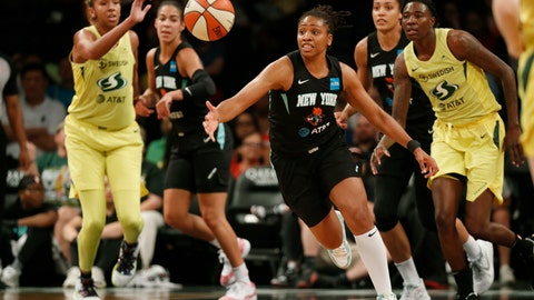 <p>               FILE - In this Aug. 11, 2019, file photo, New York Liberty guard Tanisha Wright, center, goes after a loose ball during the first half of the team's WNBA basketball game against the Seattle Storm at Barclays Center in New York. The Liberty will have a new home next year, playing their games at Barclays Center. Liberty team executives told the AP on Thursday that the franchise will play all its home contests at the Brooklyn arena that houses the Nets. The building was recently purchased by Liberty owner Joe Tsai, who also owns the Nets. Playing in Barclays Center is a huge upgrade for the Liberty, who played the past two seasons at the Westchester County Center, where the capacity was set for just over 2,000 fans. (AP Photo/Kathy Willens, File)             </p>