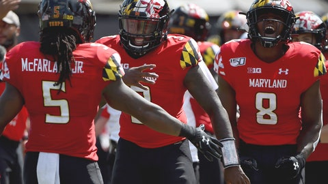 <p>               FILE - In this Sept. 7, 2019, file photo, Maryland Terrapins running back Anthony McFarland Jr. (5) celebrates with Tyrrell Pigrome (3) and Tayon Fleet-Davis (8) after scoring a touchdown against Syracuse during the first half of an NCAA college football game, in College Park, Md. Maryland's annual quarterback shuffle appears set to continue, as Josh Jackson's ankle injury sets the stage for Tyrrell Pigrome to get his first start of the season Saturday at Purdue. (AP Photo/Will Newton)             </p>