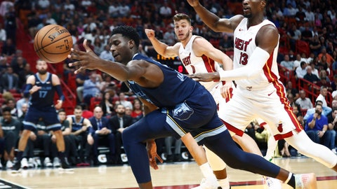 <p>               Memphis Grizzlies' Ja Morant (12) dives for the ball in front of Miami Heat's Bam Adebayo (13) and Meyers Leonard during the first half of an NBA basketball game Wednesday, Oct. 23, 2019, in Miami. (AP Photo/Brynn Anderson)             </p>