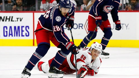 <p>               Carolina Hurricanes' Teuvo Teravainen (86), of Finland, dives to poke the puck away from Columbus Blue Jackets' Oliver Bjorkstrand (28), of Denmark, during the third period of an NHL hockey game in Raleigh, N.C., Saturday, Oct. 12, 2019. (AP Photo/Karl B DeBlaker)             </p>