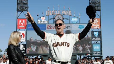 <p>               San Francisco Giants manager Bruce Bochy, center, gestures toward fans next to his wife Kim during a ceremony honoring Bochy after a baseball game between the Giants and the Los Angeles Dodgers in San Francisco, Sunday, Sept. 29, 2019. (AP Photo/Jeff Chiu, Pool)             </p>