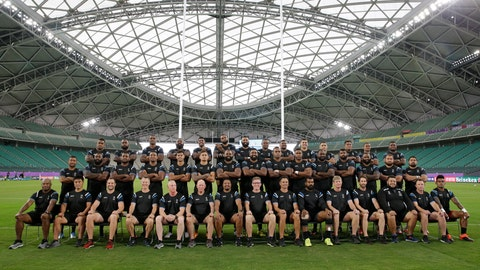 <p>               Fiji rugby team players and management pose for a group photo before their training at the Oita Stadium in Oita, Japan, Tuesday Oct. 8, 2019. Fiji will play against Wales in their Rugby World Cup Pool D game on Oct. 9. (AP Photo/Aaron Favila)             </p>