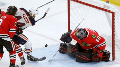 <p>               Chicago Blackhawks goaltender Corey Crawford (50) makes a point-blank save on a shot by Edmonton Oilers' Zack Kassian (44) during the third period of an NHL hockey game Monday, Oct. 14, 2019, in Chicago. (AP Photo/Charles Rex Arbogast)             </p>