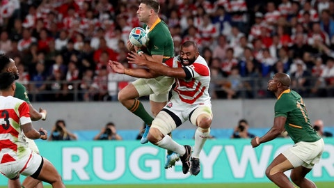 <p>               South Africa's Handre Pollard, center left, and Japan's Michael Leitch vie for the ball during the Rugby World Cup quarterfinal match at Tokyo Stadium in Tokyo, Japan, Sunday, Oct. 20, 2019. (AP Photo/Eugene Hoshiko)             </p>