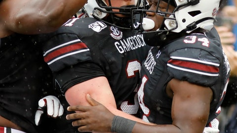 <p>               South Carolina's Mon Denson (34) is congratulated by teammates after scoring a touchdown against Florida in the first half of an NCAA college football game Saturday, Oct. 19, 2019, in Columbia, SC. (AP Photo/Mic Smith)             </p>