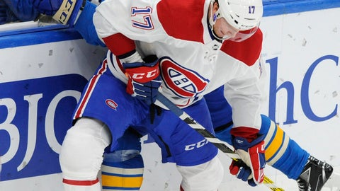 <p>               St. Louis Blues' Vladimir Tarasenko (91), of Russia, battles for the puck with Montreal Canadiens' Brett Kulak (17) during the third period of an NHL hockey game, Saturday, Oct. 19, 2019, in St. Louis. (AP Photo/Bill Boyce)             </p>