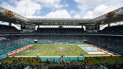 <p>               FILE - In this file photo dated Sunday, Sept. 15, 2019, The Hard Rock Stadium in Miami, USA, during a pre-game ceremony before an NFL game between the Miami Dolphins and the New England Patriots.  The Spanish soccer league said Thursday Oct. 17, 2019, it has asked the Spanish soccer federation to allow Villarreal's regular season home game against Atletico Madrid on Dec. 6 to be moved to Hard Rock Stadium in Miami. (AP Photo/Brynn Anderson, FILE)             </p>