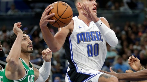 <p>               Orlando Magic's Aaron Gordon (00) looks to pass the ball as he is guarded by Boston Celtics' Enes Kanter, left, during the first half of an NBA preseason basketball game, Friday, Oct. 11, 2019, in Orlando, Fla. (AP Photo/John Raoux)             </p>