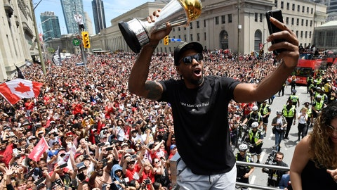<p>               FILE - In this June 17, 2019, file photo, then Toronto Raptors forward Kawhi Leonard takes a photo while holding his playoffs MVP trophy during the NBA basketball championship team's victory parade in Toronto. The NBA's balance of power has shifted to the Los Angeles Clippers, who have never advanced beyond the second round let alone won a championship. All that is expected to change behind Leonard and Paul George, both regarded as two of the best two-way players in the league. (Frank Gunn/The Canadian Press via AP, File)             </p>