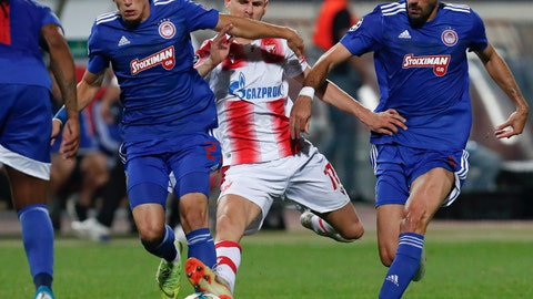 <p>               Red Star's Marko Gobeljic, center, challenges for the ball with Olympiakos' Kostas Tsimikas, left, and Andreas Bouchalakis during the Champions League group B soccer match between Red Star and Olympiacos, in Belgrade, Serbia, Tuesday, Oct.1, 2019. (AP Photo/Darko Vojinovic)             </p>
