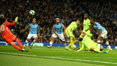 <p>               Manchester City's Raheem Sterling, right, scores his side's opening goal during the group C Champions League soccer match between Manchester City and Dinamo Zagreb at the City of Manchester Stadium in Manchester, England, Tuesday, Oct. 1, 2019. (AP Photo/Dave Thompson)             </p>