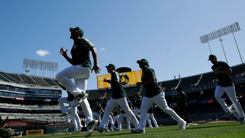 <p>               Oakland Athletics players warm up during baseball practice in Oakland, Calif., Tuesday, Oct. 1, 2019. The Athletics are scheduled to face the Tampa Bay Rays in an American League wild-card game Wednesday, Oct. 2. (AP Photo/Jeff Chiu)             </p>