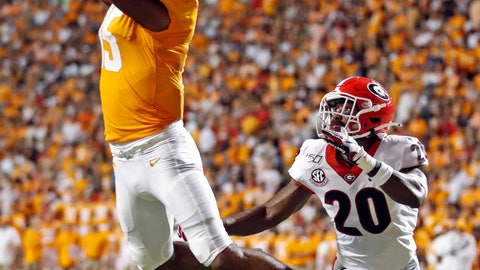 <p>               Tennessee wide receiver Jauan Jennings (15) catches a pass for a touchdown in front of Georgia defensive back J.R. Reed (20) in the first half of an NCAA college football game, Saturday, Oct. 5, 2019, in Knoxville, Tenn. (AP Photo/Wade Payne)             </p>