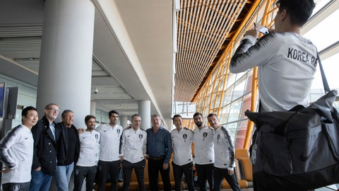 <p>               Members of the South Korean football team pose for a photo before boarding an Air China flight to Pyongyang for a World Cup qualifier match against North Korea from the airport in Beijing on Monday, Oct. 14, 2019. (AP Photo/Ng Han Guan)             </p>
