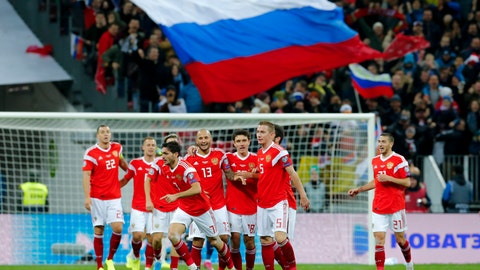 <p>               Russia's Magomed Ozdoev, foreground center, celebrates after scoring his side's second goal during the Euro 2020 group I qualifying soccer match between Russia and Scotland at the Luzhniki Stadium in Moscow, Russia, Thursday, Oct. 10, 2019. (AP Photo/Alexander Zemlianichenko)             </p>