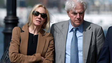 <p>               FILE - In this May 22, 2019 file photo, Marcia, left, and Gregory Abbott leave federal court after they pleaded guilty to charges in a nationwide college admissions bribery scandal. They are scheduled to be sentenced on Tuesday, Oct. 8. (AP Photo/Michael Dwyer, File)             </p>