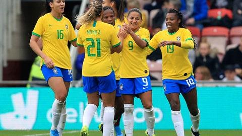 <p>               Brazils Oliveira Debora, second right, celebrates scoring against England during the international friendly soccer match at the Riverside Stadium, Middlesbrough, England, Saturday Oct. 5, 2019. (Owen Humphreys/PA via AP)             </p>
