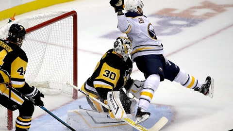 <p>               Buffalo Sabres' Zemgus Girgensons (28) collides with Pittsburgh Penguins goaltender Matt Murray (30) during the first period of an NHL hockey game in Pittsburgh, Thursday, Oct. 3, 2019. (AP Photo/Gene J. Puskar)             </p>