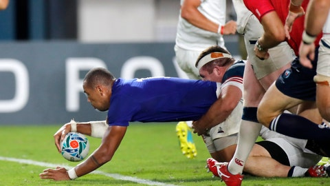 <p>               France's Gael Fickou scores a try during the Rugby World Cup Pool C game at Fukuoka Hakatanomori Stadium between France and the United States in Fukuoka, Japan, Wednesday, Oct. 2, 2019. (AP Photo/Christophe Ena)             </p>