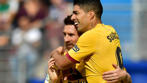 <p>               Barcelona's Luis Suarez, celebrates after scoring his side's third goal with Lionel Messi during a Spanish La Liga soccer match between Eibar and FC Barcelona at the Ipurua stadium in Eibar, Spain, Saturday Oct. 19, 2019. (AP Photo/Alvaro Barrientos)             </p>