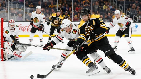 <p>               Boston Bruins' Patrice Bergeron tries to hold off Chicago Blackhawks' Adam Boqvist during the first period of an NHL preseason hockey game Saturday, Sept. 28, 2019, in Boston. (AP Photo/Winslow Townson)             </p>
