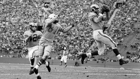 """<p>               FILE - In this Dec. 7, 1952, file photo, Los Angeles Rams' Dick """"Night Train"""" Lane leaps to intercept a Green Bay Packers pass intended for Packers' end Bob Mann (87), in the second quarter of their game before 35,000 fans  in Los Angeles. Other player shown is halfback Herb Rich (42). The hard-hitting cornerback had 68 interceptions in 14 seasons, mostly with the Chicago Cardinals and Detroit Lions in the 1950s and 60s. Lane entered the hall in 1974 and earned his nickname from his teammates from the then-popular song """"Night Train"""" during his first training camp with the LA Rams in 1952. (AP Photo/Harold P. Matosian, File)             </p>"""