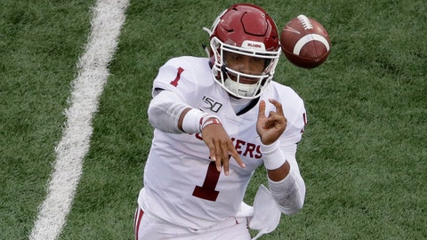 <p>               Oklahoma quarterback Jalen Hurts (1) throws a pass during the first half of an NCAA college football game against Kansas, Saturday, Oct. 5, 2019, in Lawrence, Kan. (AP Photo/Charlie Riedel)             </p>