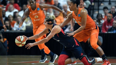 <p>               Washington Mystics' Elena Delle Donne, center, passes the ball between Connecticut Sun's Shekinna Stricklen, left, and Alyssa Thomas, right, during the first half in Game 3 of basketball's WNBA Finals, Sunday, Oct. 6, 2019, in Uncasville, Conn. (AP Photo/Jessica Hill)             </p>