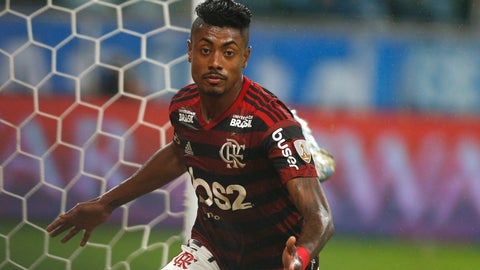 <p>               Bruno Henrique of Brazil's Flamengo, celebrates scoring his side's first goal against Brazil's Gremio during a Copa Libertadores semifinal first leg soccer match at the Gremio Arena in Porto Alegre, Brazil, Wednesday, Oct. 2, 2019. (AP Photo/Edison Vara)             </p>