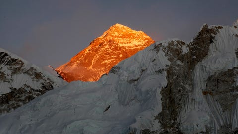 <p>               FILE - In this Nov. 12, 2015, file photo, Mt. Everest is seen from the way to Kalapatthar in Nepal. Nepal mountaineering authorities have determined that an Indian couple faked a Mount Everest ascent earlier this year by altering photographs to show they were on the summit. A Nepalese national has shattered the previous mountaineering record for successfully climbing the world's 14 highest peaks, completing the feat in 189 days. (AP Photo/Tashi Sherpa, File)             </p>