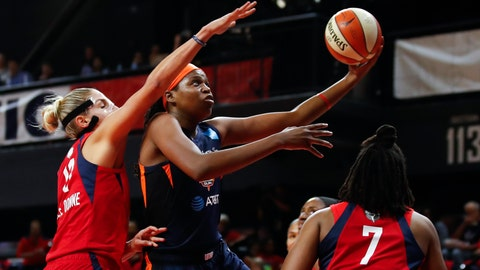 <p>               Connecticut Sun forward Jonquel Jones, center, shoots between Washington Mystics forward Elena Delle Donne, left, and guard Ariel Atkins during the first half of Game 5 of basketball's WNBA Finals, Thursday, Oct. 10, 2019, in Washington. (AP Photo/Alex Brandon)             </p>