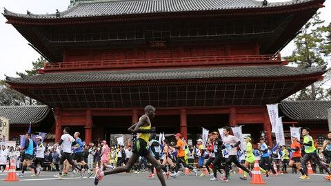 <p>               FILE - In this Feb. 23, 2014, file photo, runners pass by Zojoji Buddhist temple during the Tokyo Marathon in Tokyo. Tokyo Metropolitan Government was considering making a proposal, the start times at 3 a.m. or 5 a.m., hoping to keep the 2020 Tokyo Olympic marathon in Tokyo, Japanese news agency Kyodo News said on Thursday, Oct. 24, 2019. That could be proposed to Olympic organizers and the IOC, a move to keep the marathon from being moved out of Tokyo's summer heat to cooler summer weather 800 kilometers (500 miles) further north in Sapporo. (AP Photo/Eugene Hoshiko, File)             </p>