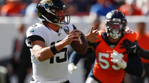 <p>               Jacksonville Jaguars quarterback Gardner Minshew, left, scrambles under pressure from Denver Broncos outside linebacker Bradley Chubb, right, during the first half of an NFL football game Sunday, Sept. 29, 2019, in Denver. (AP Photo/David Zalubowski)             </p>