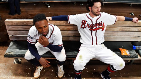 <p>               Atlanta Braves' Dansby Swanson, right, and Ozzie Albies sit in the dugout after the Braves lost 13-1 to the St. Louis Cardinals in Game 5 of their National League Division Series baseball game Wednesday, Oct. 9, 2019, in Atlanta. (AP Photo/John Amis)             </p>