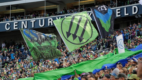 <p>               Seattle Sounders fans in the supporters section hold a sign with the Iron Front three-arrow logo during the first half of an MLS soccer match between the Sounders and Minnesota United, Sunday, Oct. 6, 2019, in Seattle (AP Photo/Ted S. Warren)             </p>