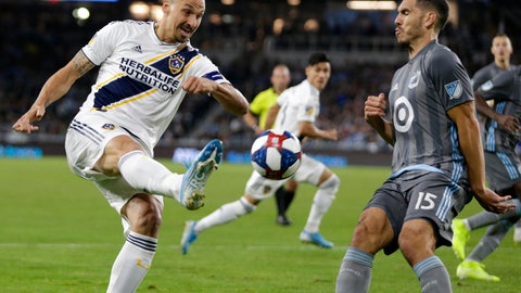<p>               Los Angeles Galaxy Mid fielder Zlatan Ibrahimovic, left, shoots in front of Minnesota United defender Michael Boxall (15) during the first half of an MLS first-round playoff match Sunday, Oct. 20, 2019, in St. Paul, Minn.(AP Photo/Andy Clayton-King)             </p>