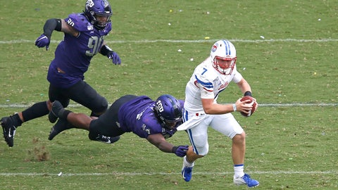 <p>               SMU quarterback Shane Buechele (7) runs the ball as TCU defensive tackle Corey Bethley (94) and defensive tackle Ross Blacklock (90) pursue during the first half of an NCAA college football game Saturday, Sept. 21, 2019, in Fort Worth, Texas. (AP Photo/Ron Jenkins)             </p>