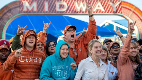 <p>               Texas fans cheer before an NCAA college football game between against Oklahoma at the Cotton Bowl, Saturday, Oct. 12, 2019, in Dallas. (AP Photo/Jeffrey McWhorter)             </p>