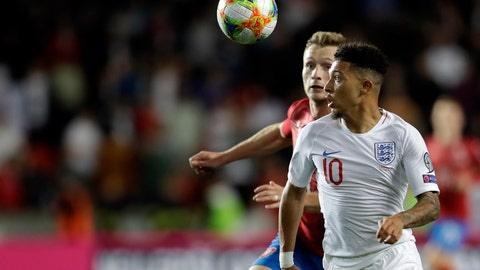 <p>               England's Jadon Sancho, front, and Czech Republic's Jakub Brabec run for the ball during the Euro 2020 group A qualifying soccer match between Czech Republic and England at the Sinobo stadium in Prague, Czech Republic, Friday, Oct. 11, 2019. (AP Photo/Petr David Josek)             </p>