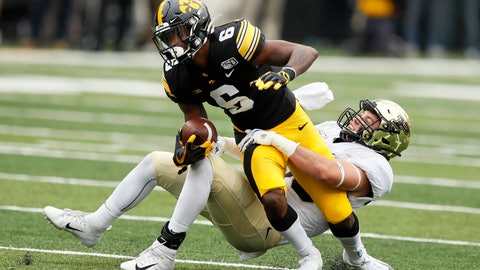 <p>               Iowa wide receiver Ihmir Smith-Marsette (6) is tackled by Purdue safety Brennan Thieneman, right, after catching a pass during the second half of an NCAA college football game, Saturday, Oct. 19, 2019, in Iowa City, Iowa. Iowa won 26-20. (AP Photo/Charlie Neibergall)             </p>