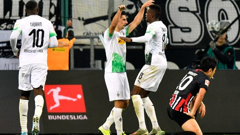 <p>               Moenchengladbach's Denis Zakaria, center right, celebrates after scoring his side's fourth goal during the German Bundesliga soccer match between Borussia Moenchenglabach and Eintracht Frankfurt in Moenchengladbach, Germany, Sunday Oct. 27, 2019. (AP Photo/Martin Meissner)             </p>