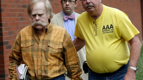<p>               FILE - In this June 10, 2013, file photo, Harvey Updyke, left, leaves the Lee County Justice Center in Opelika, Ala., with his bail bondsman and his attorney. Updyke, the University of Alabama fan convicted of poisoning Auburn University's oak trees, failed to attend a hearing, Wednesday, Oct. 30, 2019, on why he hasn't paid court-ordered restitution. (AP Photo/Dave Martin, File)             </p>