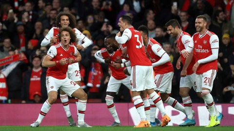 <p>               Arsenal's David Luiz, front left, celebrates with teammates after scoring his side's second goal during the English Premier League soccer match between Arsenal and Crystal Palace at the Emirates stadium in London, Sunday, Oct. 27, 2019. (AP Photo/Leila Coker)             </p>