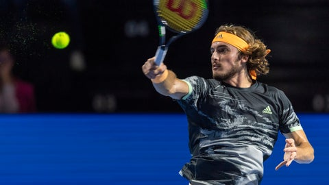 <p>               Greece's Stefanos Tsitsipas returns a ball to Spain's Albert Ramos-Vinolas during their first round match at the Swiss Indoors tennis tournament at the St. Jakobshalle in Basel, Switzerland, on Tuesday, Oct. 22, 2019. (Georgios Kefalas, Keystone via AP)             </p>