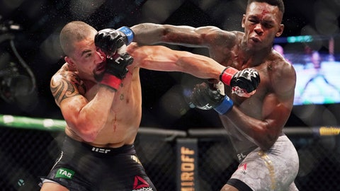 <p>               Robert Whittaker of Australia, left, is hit by Israel Adesanya of New Zealand as they compete during UFC 243 in Melbourne, Sunday, Oct. 6, 2019. Interim champion Adesanya dethroned UFC middleweight champion Whittaker with a knockout in the second round of their 185-pound unification bout. (Michael Dodge/AAP Image via AP)NZ             </p>