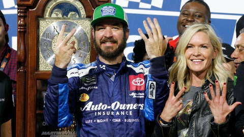 <p>               Martin Truex Jr., left, and his girlfriend Sherry Pollex, right, pose with the trophy as he celebrates after winning a NASCAR Cup Series race at Martinsville Speedway in Martinsville, Va., Sunday, Oct. 27, 2019. (AP Photo/Steve Helber)             </p>